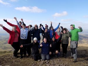 Picture of a young people at the top of Lorf Herefords Knob in the Becon Beacons