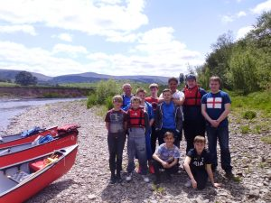 Picture of a club about to go canoeing on the River Wye
