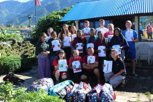 EBGC Young people holding donations to give to the Barpak Mothers group.