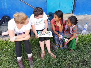 EBGC Young people with children from Nepal reading together