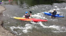 Young person going down the River Wye at the 100 Mile Canoe Test