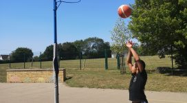 Young Person playing basketball